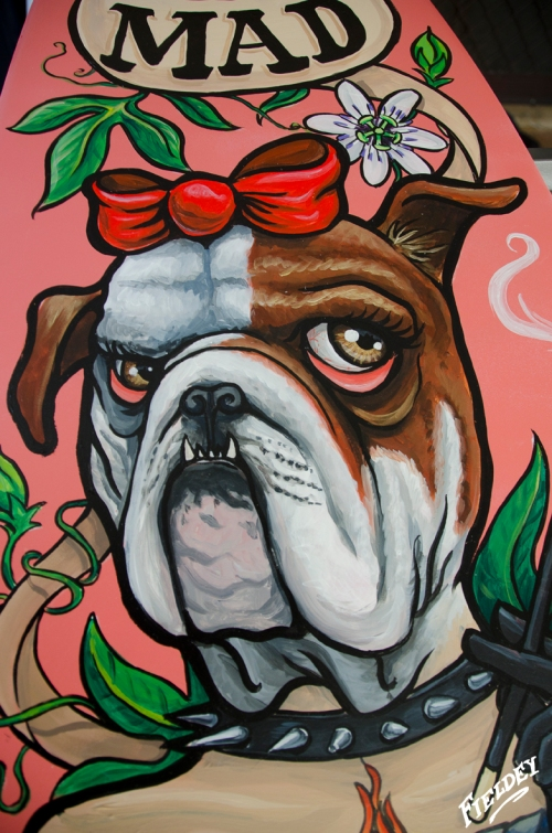 Bulldog head lady painted on surfboard, old school tattoo style