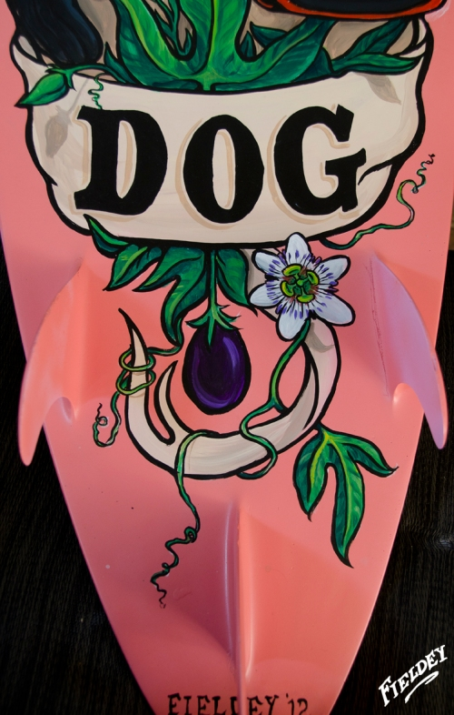 Painted surfboard showing old-school tattoo style banner and typeface