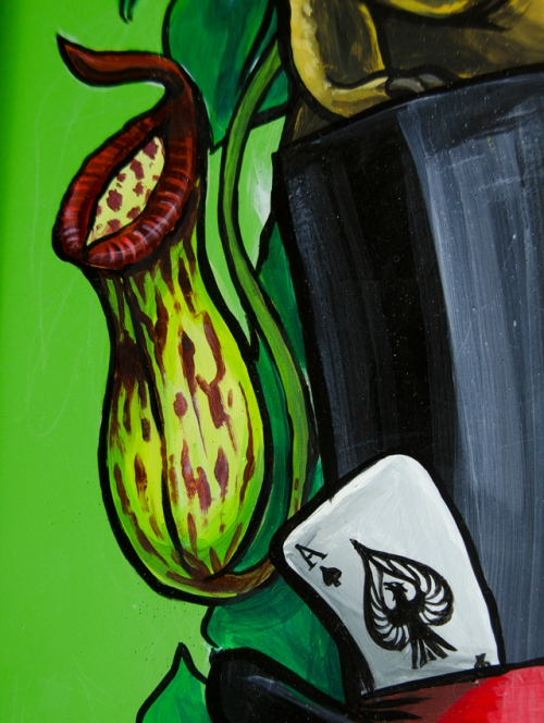 pitcher plant and ace of spades on a painted surfboard