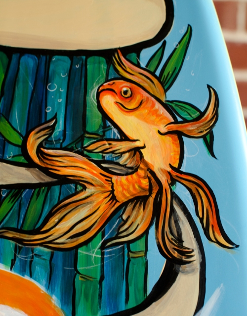 Goldfish painted on a surfboard