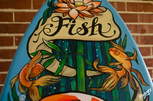 Gold fish painted in old school tattoo style