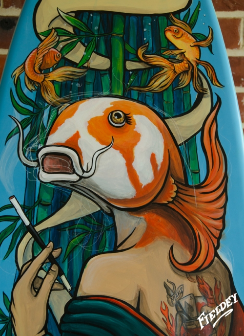 Fish - headed woman painted on surfboard