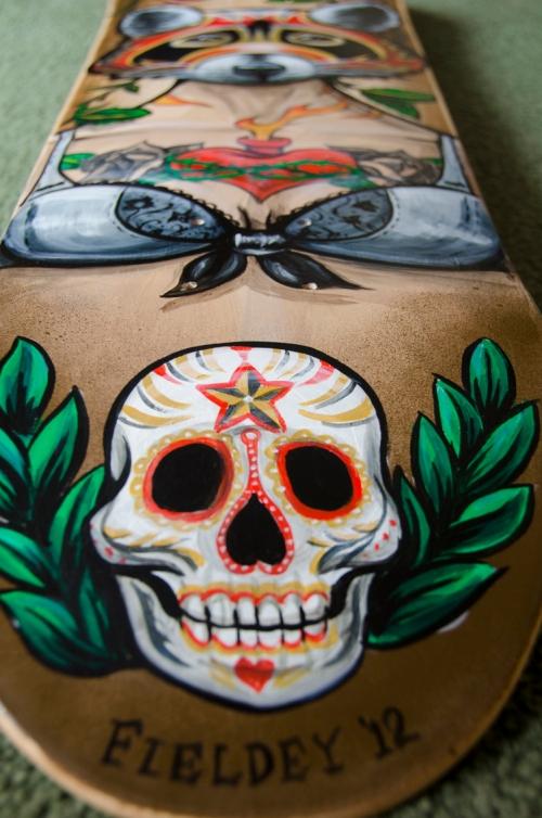 Mexican Dia de los muertos skull on skateboard deck