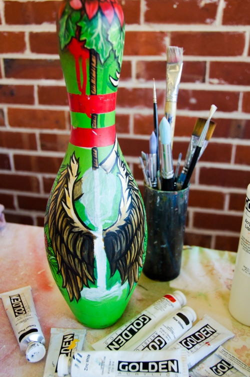 Custom painted bowling pin in progress with wings