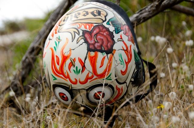 Custom painted surf helmet with skull and brains