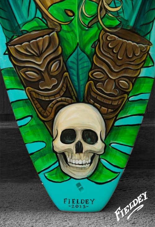 Painted surfboard with Tiki detail