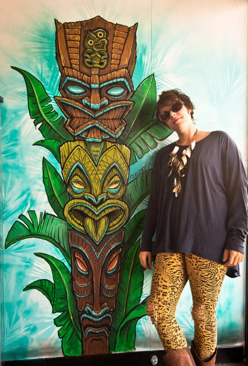 Fieldey in front of her Tiki Totem graffiti mural in Northbridge